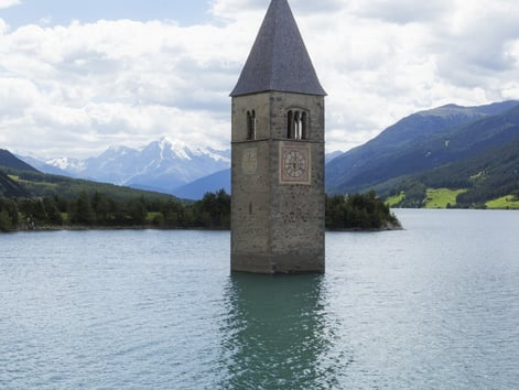 The popular church tower in Resia Lake